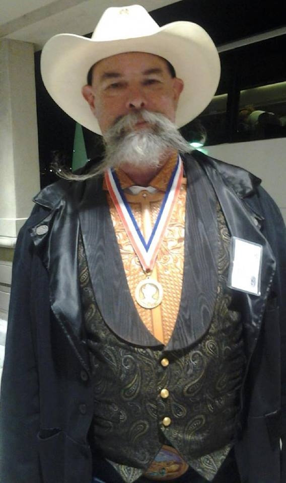 Wayne Al Stohlman award for achievement in leathercraft for his leatherwork teaching and promotion